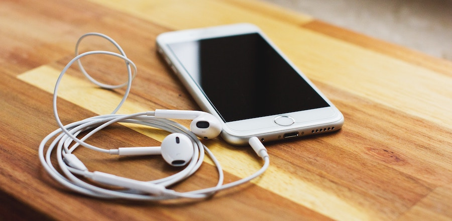 iphone and earbuds listening